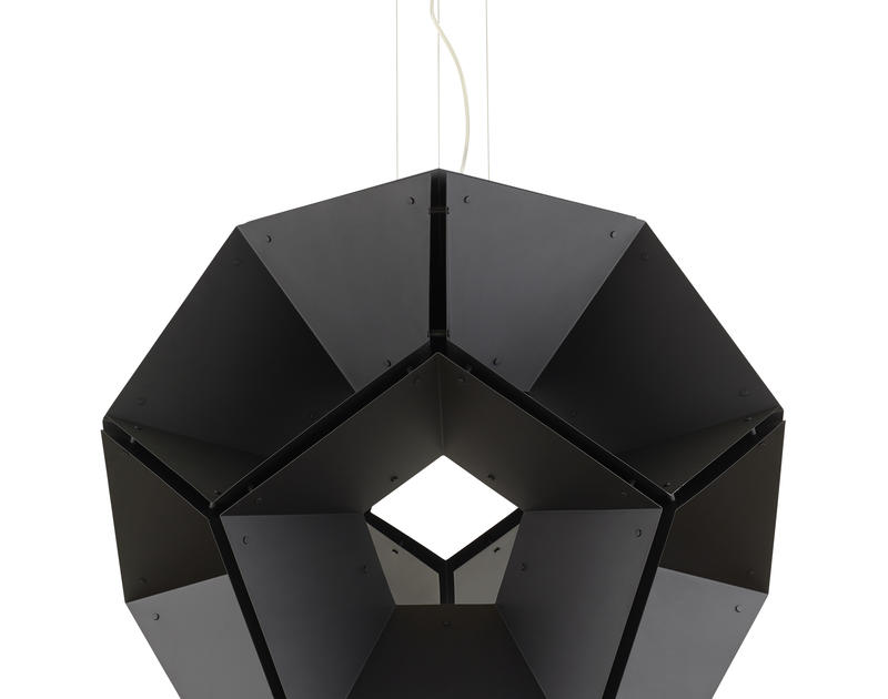 The versatile, honeycomb pendant reads ultra-modern or as a stylized interpretation of nature, depending on context.