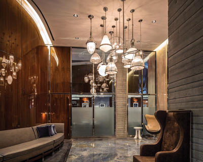 Rockwood pulls on the secondary glass doors complement the 6-ft. pulls on the hotel's soaring 12-ft. wood main doors.
