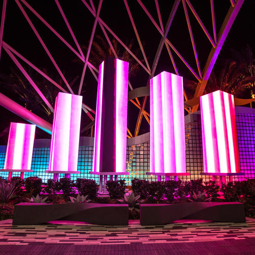The design concept included multiple free-standing columns of LED screens displaying changing visual patterns set in front of a dynamic curtain of flapper-panel walls.