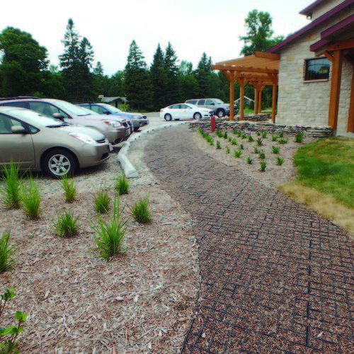 The limestone crushed aggregate used for the parking area and the contrasting colored buckshot crushed aggregate for the walkways were both obtained locally.