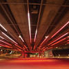 """When entering the underpass the color-changing lighting effects provide a dynamic display. There are also lighting fixtures under benches (below) to provide a soft glow for adjacent walking surfaces, which gives the paths a """"romantic"""" feel in contrast to the underpass lighting."""